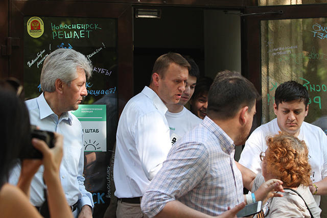 Alexei Navalny and Leonid Volkov speaking with representatives from the National Liberation Movement on July 17, 2015.