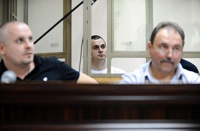 Lawyer Dmitry Dinze (left) and film director Oleg Sentsov (center)