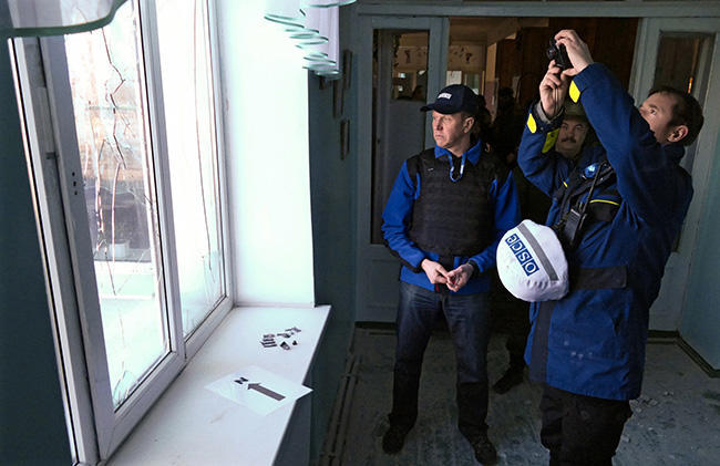 OSCE observers document the effects of Ukrainian army shelling upon villages in Staromykhailivka (near Donetsk), February 18, 2016.