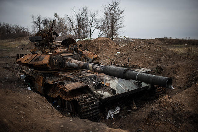 A Ukrainian tank disabled along the road into the village of Metalist, outside Luhansk. November 13, 2014.