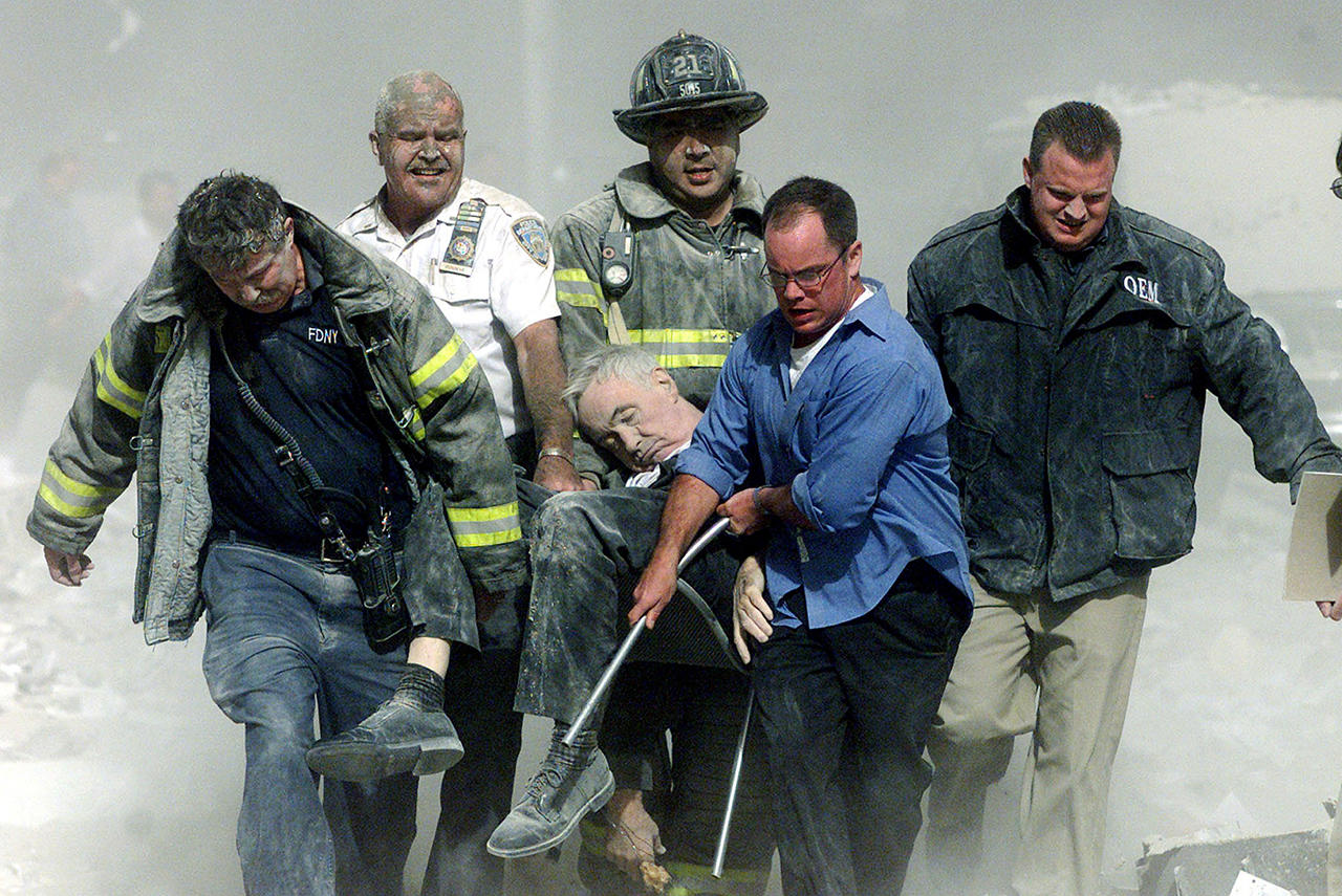 time photo essay 9/11 Nearly 3,000 people in new york, virginia, and pennsylvania lost their lives on 9/11 after terrorists orchestrated by osama bin laden hijacked airplanes as weapons.