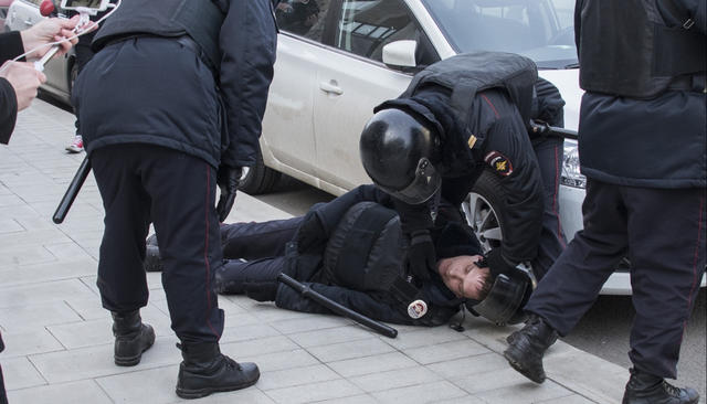 Policeman Evgeny Gavrilov shortly after his was struck by an unidentified person in Moscow on March 26, 2017.