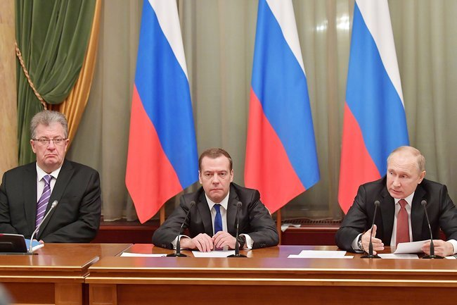 From left to right: Deputy Prime Minister Sergey Prikhodko, Prime Minister Dmitry Medvedev, and President Vladimir Putin at an end-of-the-year cabinet meeting, December 26, 2017