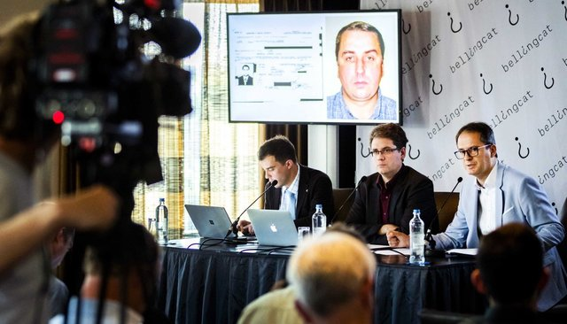 A photograph of Oleg Ivannikov, shown at Bellingcat's press conference on May 25