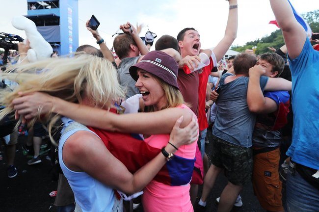 Fans celebrate Russia's victory at the fan zone in Moscow, July 1, 2018