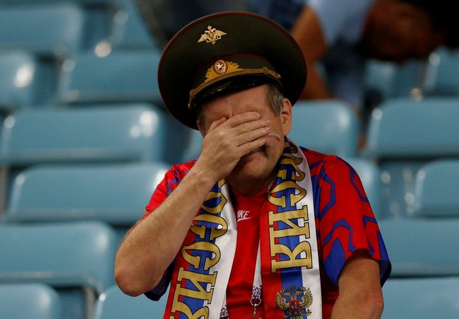 A Russian fan is left in tears after the team loses on penalty kicks against Croatia on Saturday, failing to reach the World Cup semifinals. Sochi, July 7, 2018