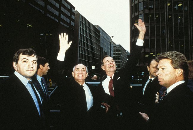 Mikhail Gorbachev and George Bush greet a crowd in Washington, D.C. December 1987.