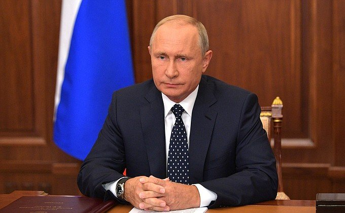 Putin softens raising of retirement age in rare TV address