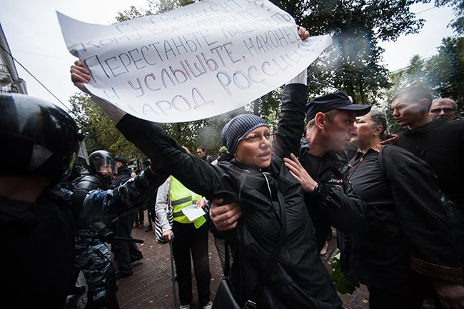 "Yekaterinburg. (Sign reads, ""Cut the hypocrisy and list at last to the people of Russia!"")"