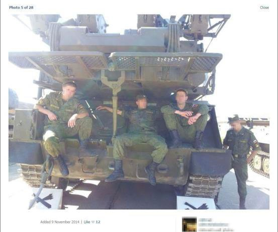 "Russian soldiers and their ""Buk"" missile system. This photo was published in November 2014, but researchers at Bellingcat believe it was taken earlier that summer."