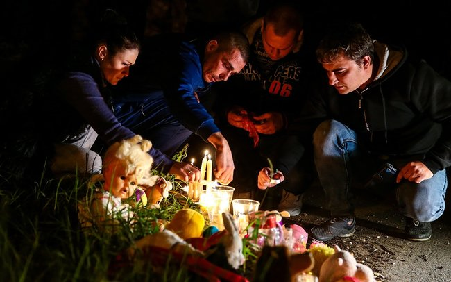 Mourners gather at the makeshift memorial outside the Kerch Polytechnic College, October 18, 2018
