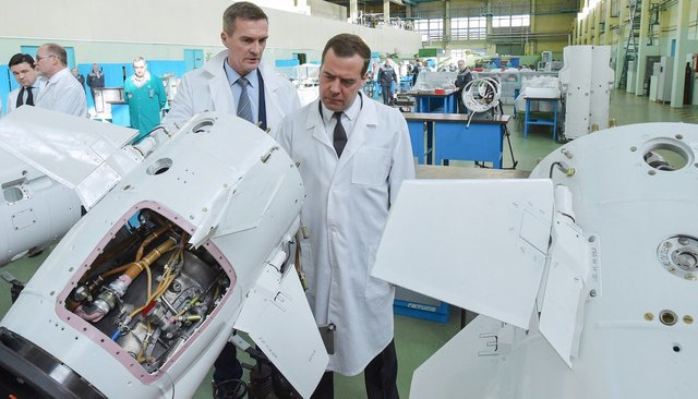 Tactical Missiles Corporation CEO Boris Obnosov and Prime Minister Dmity Medvedev visit the company's assembly shop in Korolyov, March 10, 2015