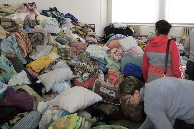 Blankets, pillows, and other items donated to the apartment blast victims. January 1, 2019