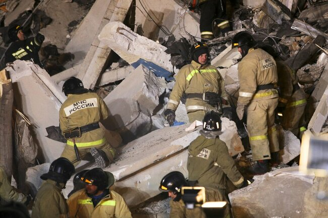 Rescue workers sift through debris after the explosion. December 31, 2018.