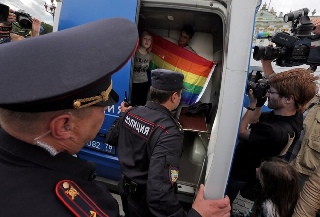 Supporters of the LGBTQ community are forced into a police vehicle in St. Petersburg's Palace Square. August 2, 2015
