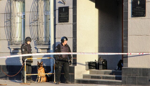 A team investigates the Arkhangelsk FSB building after a bombing took place there on October 31, 2018