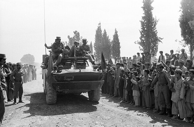 Residents of the Afghan regional capital Khost greet Soviet soldiers returning from an operation against the mujahideen. May 26, 1986