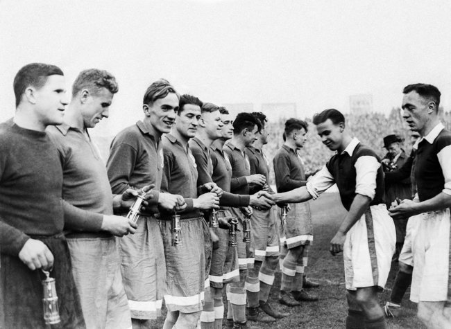 Dynamo and Cardiff City players shake hands before a match. Dynamo won 10 – 1. November 17, 1945