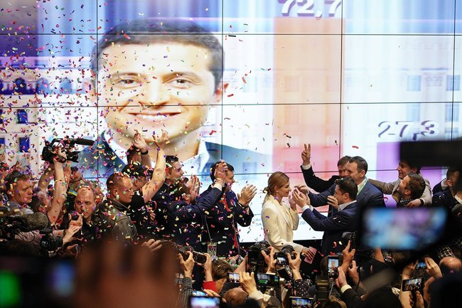 The crowd in Zelenskiy's headquarters reacts to exit poll results. April 21, 2019