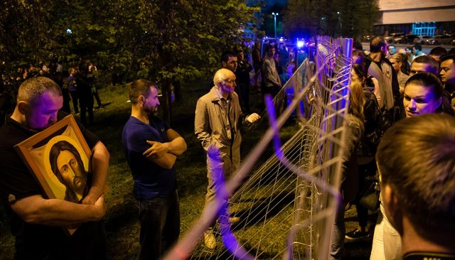 Protesters gather at night in Yekaterinburg against the construction of a new church