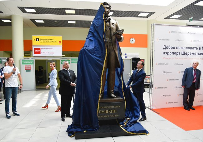 """Moscow's Sheremetyevo International Airport was recently <a href=""""https://www.themoscowtimes.com/2019/05/31/pushkin-lomonosov-tupolev-russian-airports-get-a-name-change-a65832"""" target=""""_blank"""">renamed</a> in honor of the poet Alexander Pushkin. To celebrate the change, officials installed a monument to Pushkin inside the airport on June 5. Culture Minister Vladimir Medinsky participated in the monument's unveiling ceremony. The sculpture itself, created by Alexander Burganov, portrays the poet reciting a poem aloud, the airport's press service <a href=""""https://www.mskagency.ru/materials/2896198"""" target=""""_blank"""">explained</a>. The spine of the book in the poet's hand features a hidden QR code that allows travelers to download an audiobook of Pushkin's works. The sculpture joins at least 11 other major monuments to Pushkin in the Russian capital alone."""