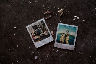 Family photos left in an abandoned apartment.