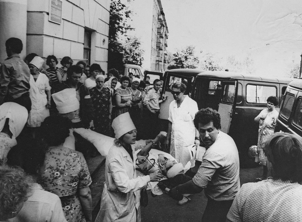 The wounded are loaded into an ambulance. June 4, 1988.