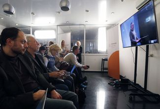 Open Russia workers in Moscow watch an online press conference given by Khodorkovsky. December 9, 2015
