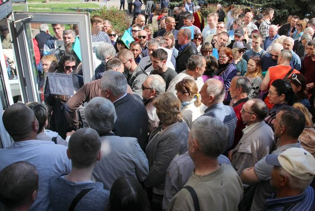 People line up at the opening of Luhansk's first passport center for processing Russian citizenship applications