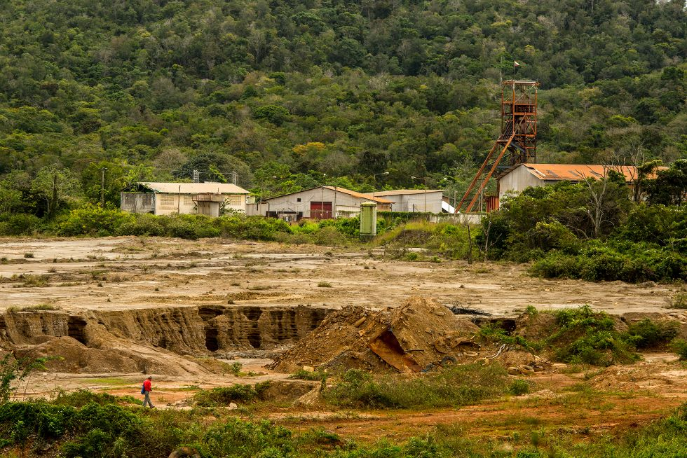 A miner walks on property owned by state gold processor Minerven in the violently contested, mineral-rich town of El Callao, Bolivar State, Venezuela. February 27, 2018