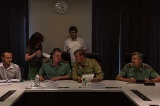 A meeting of the committee for market nationalization, comprised of the DPR People's Council deputies. Third from the left is the committee chairman, Colonel Sergei Zavdoveyev.