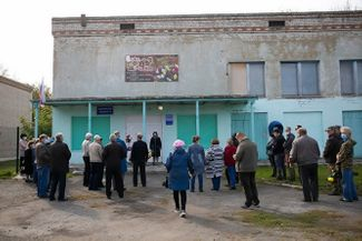 Locals gather following Podoksenov's death in Pervomaisky