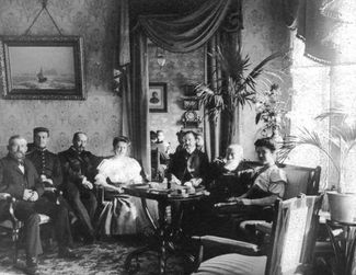 The parlor at 16 Bolshoy Dmitrovka, where Professor Vladimir Mikhailovich Chaplin (Vera Chaplina's uncle), a scientist and engineer, lived. In the center is Vera's mother, Lydia Chaplina. About 1904.