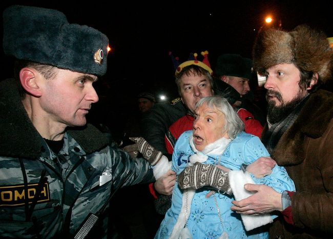Police officers detain Lyudmila Alexeyeva during the Strategy 31 rally at Triumfalnaya Square on December 31, 2009