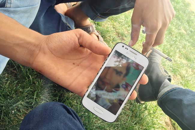 Akhmed from Syria shows a photo of his older brother, killed by militants in Jarabulus.