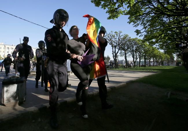 Police detain a participant at a rally on International Day Against Homophobia, Transphobia, and Biphobia in St. Petersburg on May 17, 2019