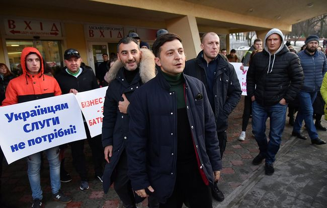Volodymyr Zelenskiy stands in front of demonstrators protesting his candidacy before a performance in Lviv. February 8, 2019