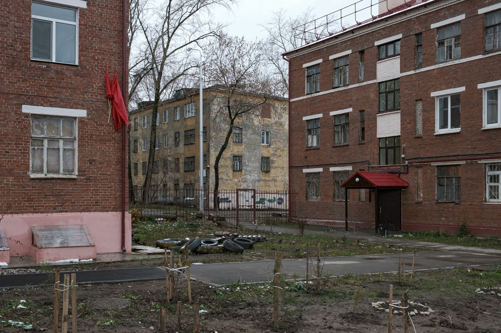 The yard between 13 Tsiolkovsky Street and 11 Tsiolkovsky Street.