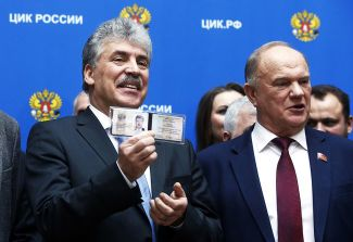 Communist Party presidential candidate Pavel Grudinin (left) and party chairman Gennady Zyuganov, after the former's registration with Russia's Central Election Commission in Moscow, January 12, 2018