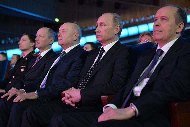 Russian Foreign Intelligence Service chief Mikhail Fradkov (3rd left), Russian president Vladimir Putin and Russian Federal Security Service (FSB) head Alexander Bortnikov attend a gala evening marking the Security Agency Worker's Day at the State Kremlin Palace. December 20, 2014