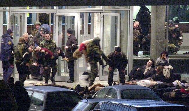 Before raiding the building, police use the ventilation system to flood the theater with knockout gas, after which Interior Ministry forces and FSB agents storm in. Officials say the terrorists' explosives necessitated the use of knockout gas. The exact makeup of the gas pumped into the theater is still unknown to this day.