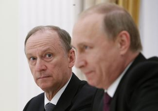 Security Council Secretary Nikolai Patrushev seated beside Vladimir Putin at the Kremlin in 2015 during the president's meeting with the leaders of other BRICS nations