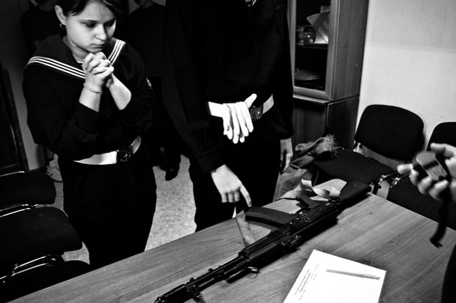 """Conscript's Day"" in a regional youth club as part of the military-patriotic education program. A timed competition of assembling and disassembling an assault rifle. St Petersburg, 2010."