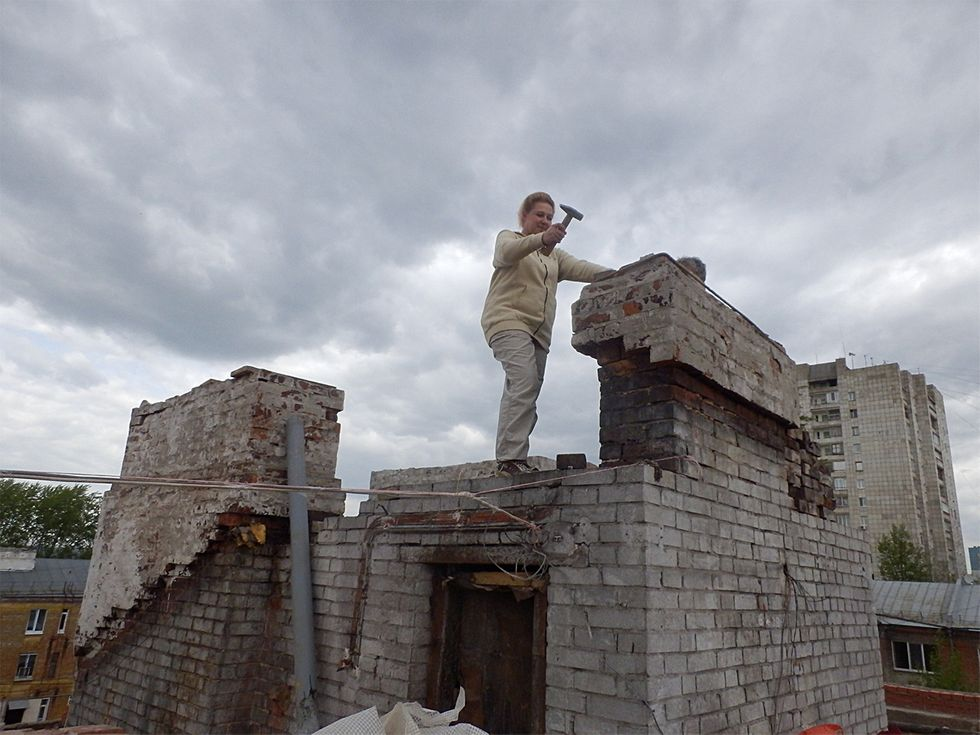 Anastasia Maltseva on the roof of her building during the renovation.