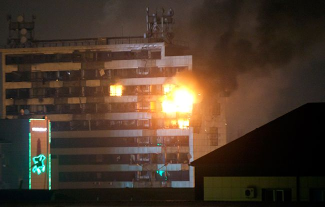 Burning building Dom pechati (Printing House), in which there were militants, who attacked Grozny. December 4, 2014