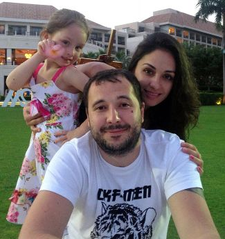 Roman Seleznev with his girlfriend, Anna Otisko, and her daughter, July 11, 2014.