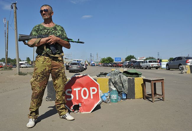 "The ""Izvarino"" checkpoint on the Russian-Ukrainian border, controlled by Lugansk People's republic militia"