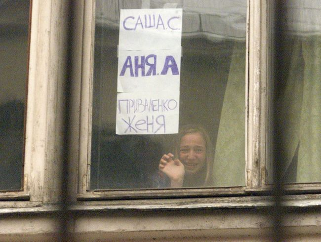 "As a result of the terrorist attack, according to different reports, anywhere from 130 to 174 hostages were killed. The official hostage death count is 130 people, 119 of whom died in hospitals after being freed. (Sign reads, ""Sasha S., Anya A., Zhenya Privalenko."")"