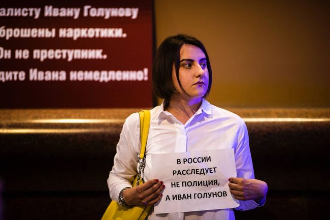 "Sign reads, ""In Russia, it's not the police who investigate, but Ivan Golunov."""