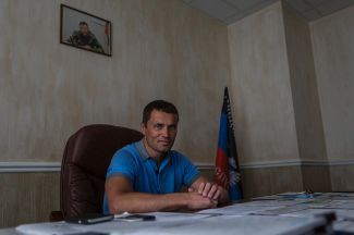 The minister of construction, housing, and public utilities of the Donetsk People's Republic, Sergei Naumets, in his office.